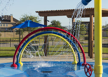 Laugh and play at SplashPad Texas